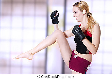 Woman fighter knee kick. - Young sexual lady fighter kicking...