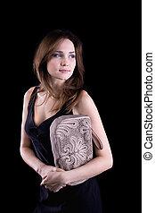 Young woman with linen handbag