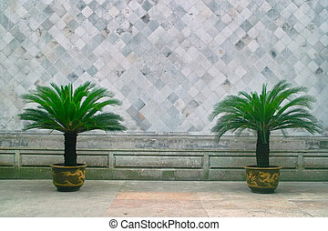 Chinese traditional style brick wall with dwarf potted...
