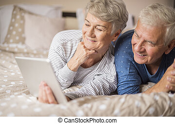Senior couple looking for something in the Internet