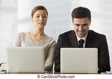 Interested curious businesswoman looking at businessman...