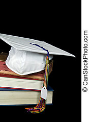 Costly Cap - Price tag hanging from a white graduation cap