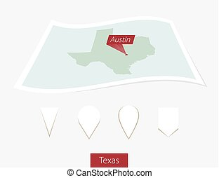 Curved paper map of Texas state with capital Austin on Gray...