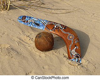Boomerang and coconut. - Colorful boomerang and coconut on a...