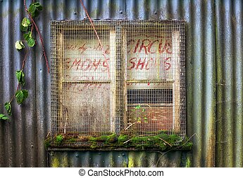 Old boarded up window - A boarded and secured window in an...