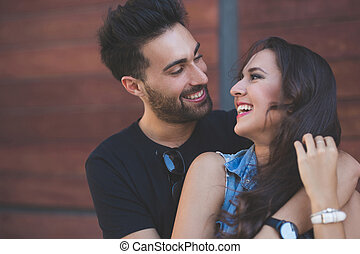 Happy couple embracing together laughing - Close up portrait...