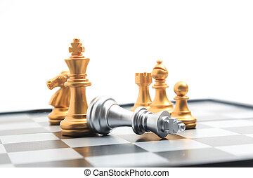 Chess board game gold player killed silver king for business competition metaphor winner and loser concept shallow depth of field