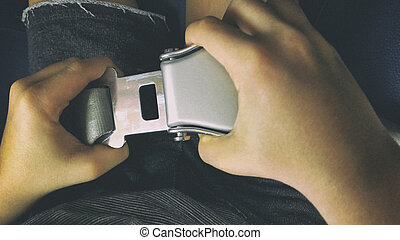 Boy buckle up airplane seat belt - POV top view of boy...
