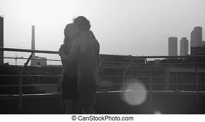 Silhouettes of young couple dancing on sunset - Silhouettes...