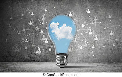 Blue cloudly skyscape inside lightbulb. - Lightbulb with...