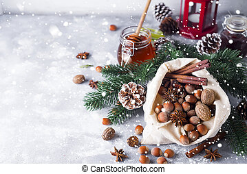 Festive christmas nuts and spices tumbling from a burlap bag...
