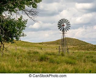 Windmill in Nebraska Sandhills - A windmill stands in...