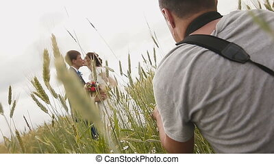 Photographer taking pictures couple of newlyweds