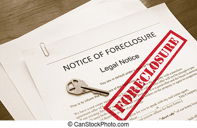 home foreclosure legal document with house key
