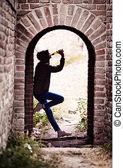 Lonely Teenager Girl Drinking Beer in Doorway