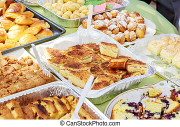 Delicious desserts and cakes on the buffet table