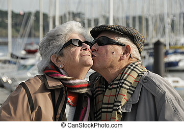 Old happy senior couple - Happy old french couple walking...