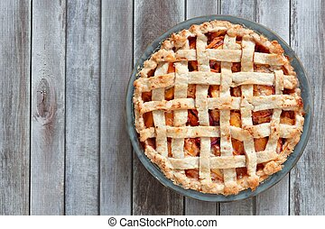 Homemade peach pie, above view on wood - Rustic homemade...