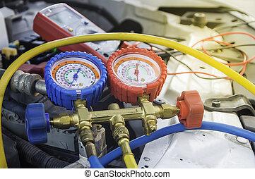 Auto mechanic uses a pressure gauge on the air compressor,liquid air pressure,compressor,manometer in a car.