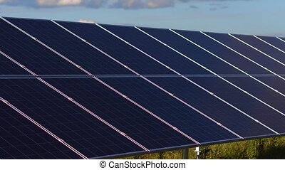 View of solar energy panels installed in the field. Footage...