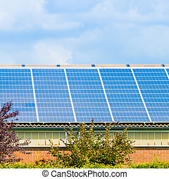Solar panel on a roof of a house.  alternative energy photovoltaic solar panels