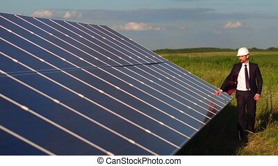 Footage with solar energy panels installed in the field. Man...