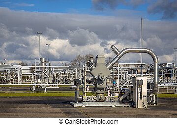 Natural gas well with piping - Wellhead on fossil fuel...
