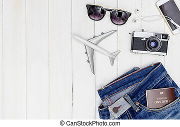 Hipster male travel objetcs and fashion on white wooden copy...