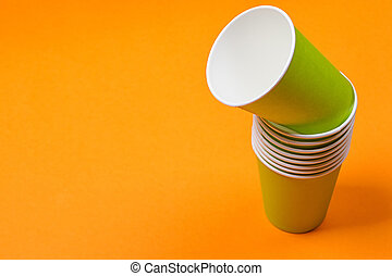 recycling colorful paper glass on the orange background