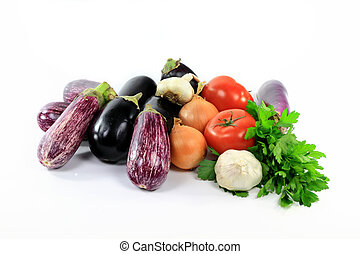 Pile assorted Eggplants and vegetables on white. - Pile of...