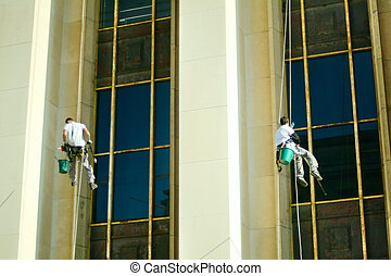 Professional window cleaner with protection equipment at work