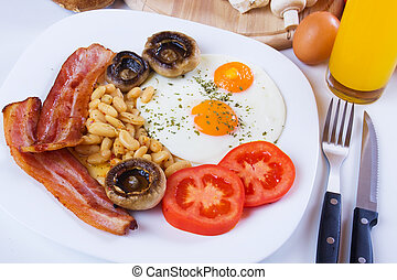 English breakfast - Fried eggs, bacon, beans and mushrooms...