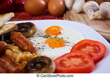 Fried eggs for breakfast - Fried eggs served with tomato,...
