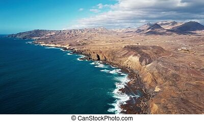 Flying over cliffs in La Pared, Fuerteventura, Canary...