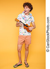 Full length portrait of a happy guy in summer clothes