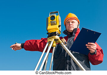 surveyot theodolite works - Surveyor worker making...