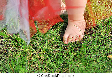 Close up of baby's feet on green grass - Close up of baby's...
