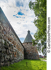 The high stone wall of the Spaso-Preobrazhensky Solovetsky...