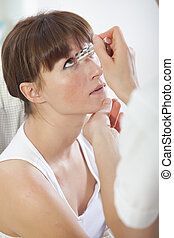 doctor checking patient eyes - doctor shines a light into...
