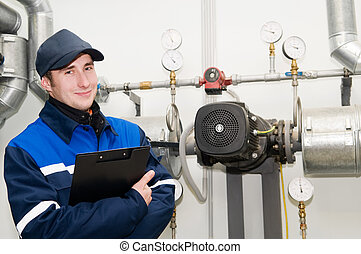 heating engineer in boiler room - glad maintenance engineer...