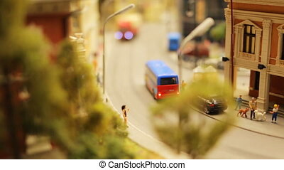Close-up toy city street bus cur peoples