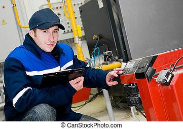 heating engineer in boiler room - happy maintenance engineer...