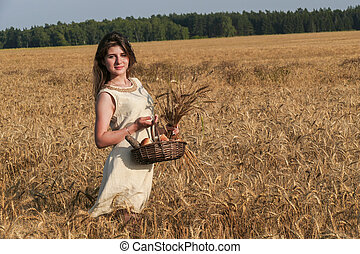 Young attractive woman in beatiful natural dress walking...
