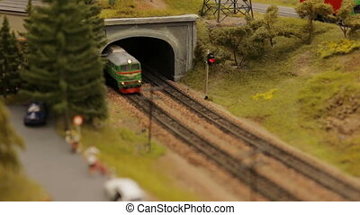 Close-up toy town train tunnel - Close-up toy town train and...