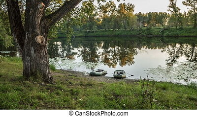 Lake with two boats on the shore, panorama