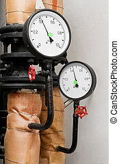 Manometers in Heating system - Closeup of manometer, pipes...