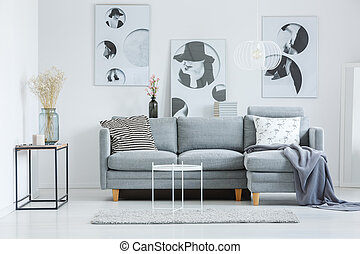 Fashionable living room with sofa - Glass vase on shelf near...