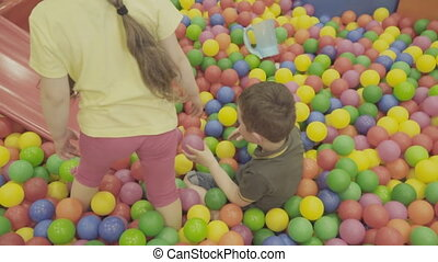 Children play in a big pile of balls