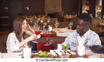 People dining at restaurant, lifestyle in resort, man and woman on honeymoon, husband and wife celebrating anniversary.
