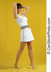 Beautiful girl model pose on yellow background